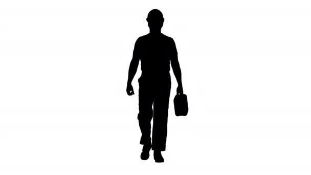 Silhouette Bauarbeiter mit Hut hält Plastikkanister in der Hand und geht.