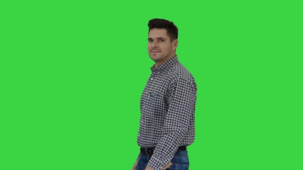 Smiling worker doing ok gesture with hammer in hand on a Green Screen, Chroma Key.