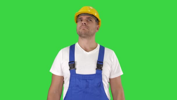 Construction worker unhappy about the result of the work Being disappointed on a Green Screen, Chroma Key.