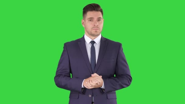 Smiling businessman clapping hands on a Green Screen, Chroma Key.