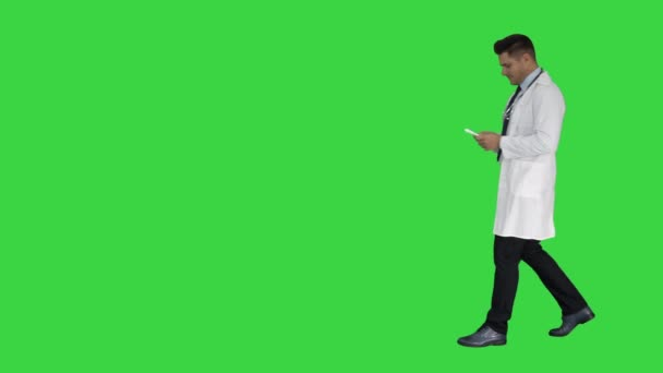 Doctor physician presenting medicine on a Green Screen, Chroma Key.
