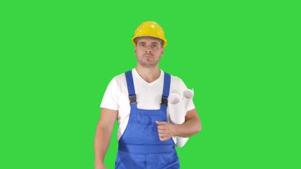Inspector Engineer Man Looking Around While Walking on a Green Screen, Chroma Key.