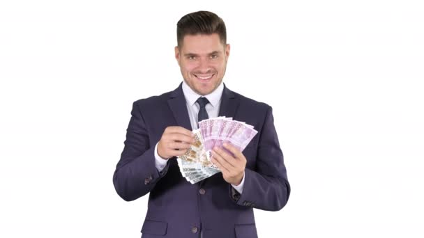 Business man showing euro banknotes smiling on white background.