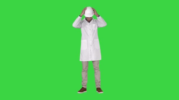 Arab engineer in white robe putting hard hat on Safety concept on a Green Screen, Chroma Key.