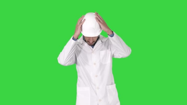 Scientist engineer in safety glasses and hard hat walking Safety concept on a Green Screen, Chroma Key.