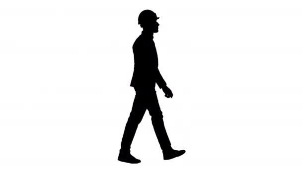 Silhouette Architect in white helmet walking.