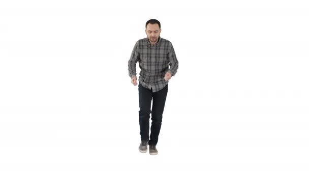 Young man in a casual outfit walking and dancing on white background.