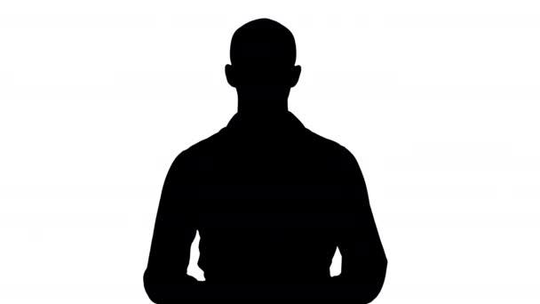 Silhouette Arab fiatalember ing beszél bemutató valamit, és arra mutat, hogy az oldalán.