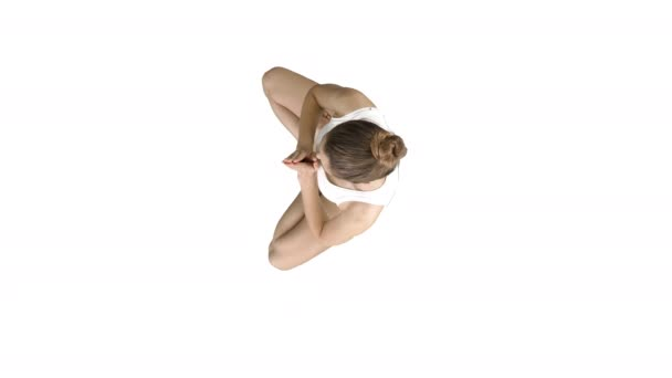 Young caucasian blonde woman practicing yoga on white background.
