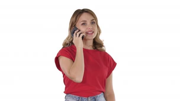 Young beautiful woman in red t-shirt speaks on mobile phone on white background.