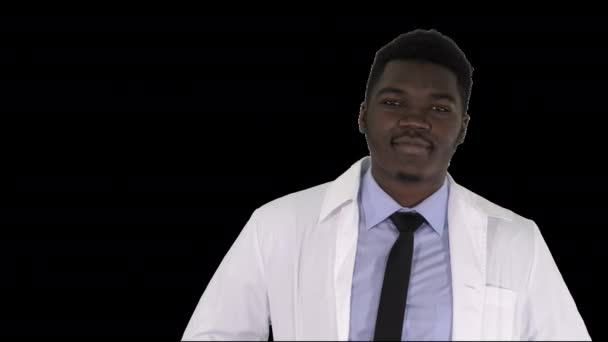 Male African Doctor Standing With Hands In His Pockets, Alpha Channel