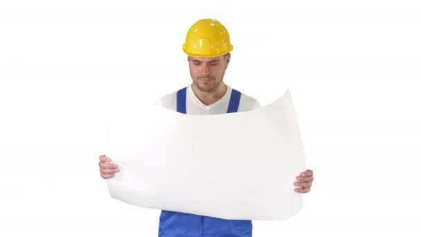 Construction worker checking blueprints on site on white background.