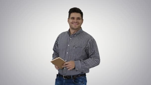 Casual man looking around smiling happy with something that he sees on gradient background.
