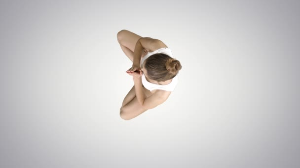 Young caucasian blonde woman practicing yoga on gradient background.