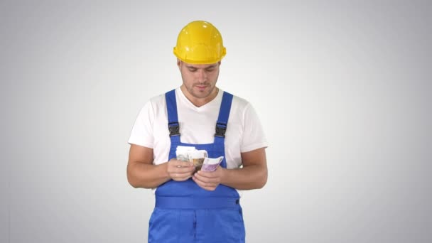 Builder counting money standing on gradient background.