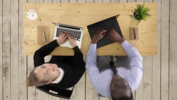 Business team working using laptops