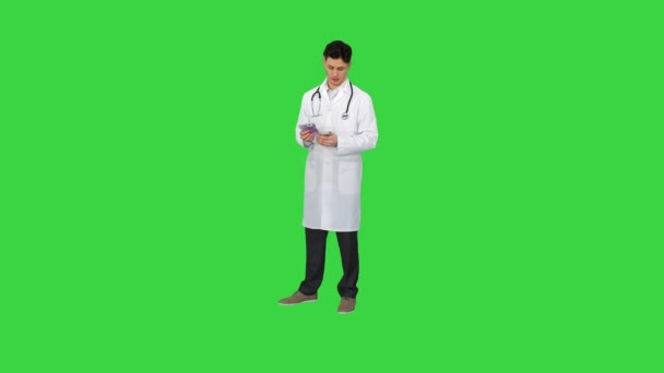 Doctor counting euro and dancing on a Green Screen, Chroma Key.
