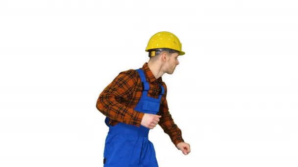 Young construction worker in hard hat dancing hip-hop on white background.