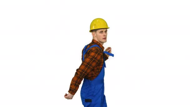 Dancing young engineer with helmet after work on white background.