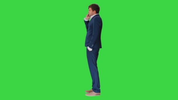 Stressed and angry businessman talking on the phone on a Green Screen, Chroma Key.