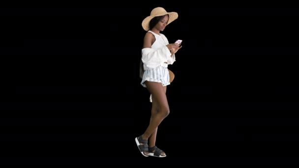 Attractive young african woman in summer dress using mobile phone, Alpha Channel