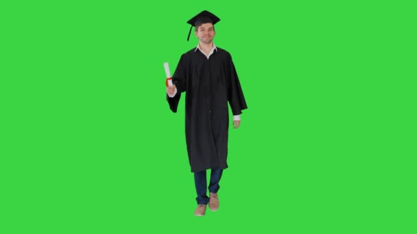 Man walking to the graduation ceremony on a Green Screen, Chroma Key.
