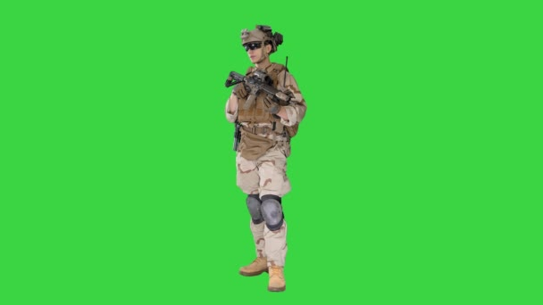 Soldier Standing looking to the side and Listening Orders on a Green Screen, Chroma Key.