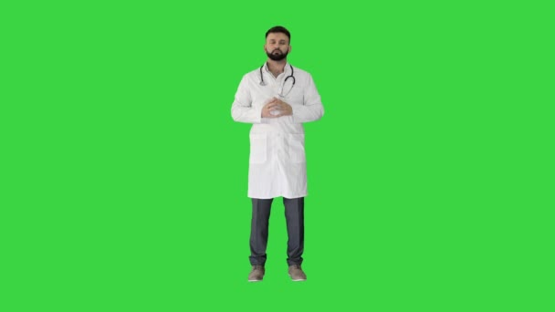 Confident turk doctor standing and looking to camera on a Green Screen, Chroma Key.