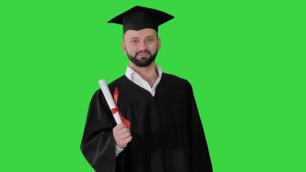 Young smiling man on his graduation day on a Green Screen, Chroma Key.