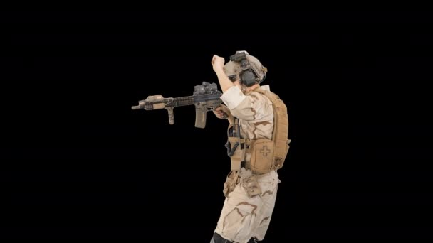 United states ranger walking in, making hold gesture and then making go gesture, Alpha Channel