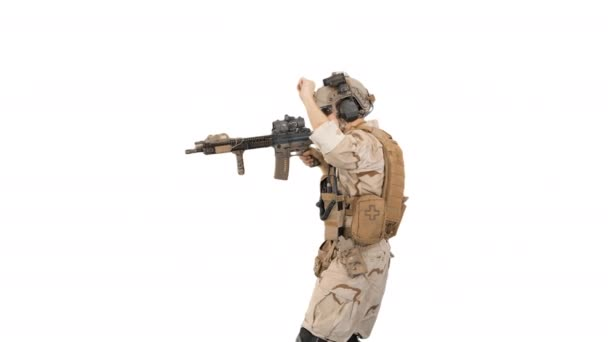 United states ranger walking in, making hold gesture and then making go gesture on white background.
