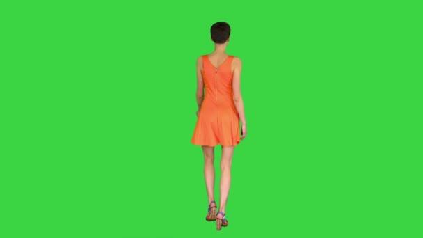 Girl Dancing in Orange SunDress on a Green Screen, Chroma Key.