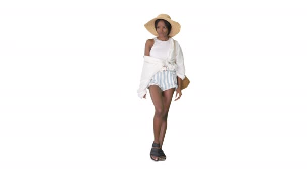 Young african american woman wearing summer hat looking tired and bored on white background.