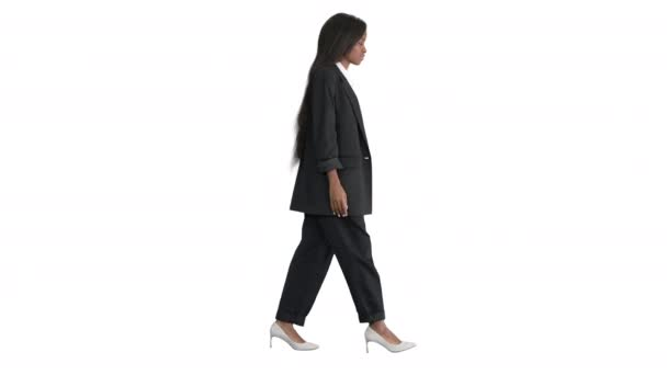 Casual African American Businesswoman walking on white background.