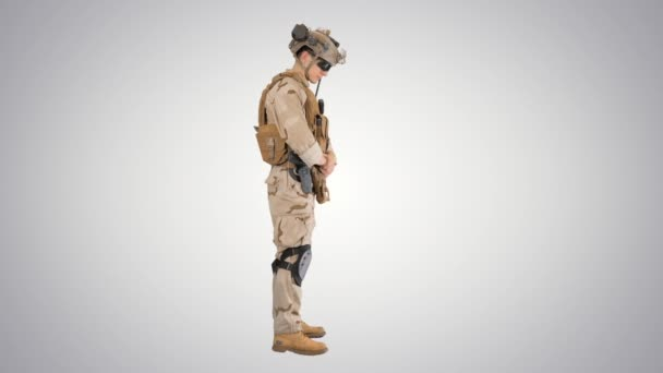 Soldier standing waiting and doing nothing on gradient background.