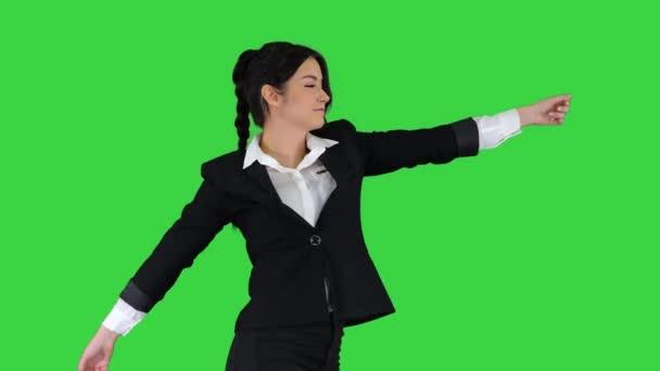 Businesswoman Dancing on a Green Screen, Chroma Key.