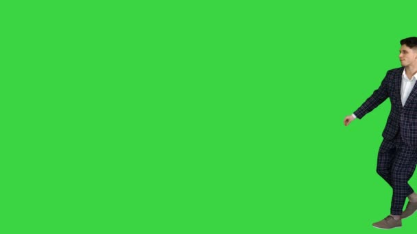 Cool man in formal outfit walking and dancing on a Green Screen, Chroma Key.