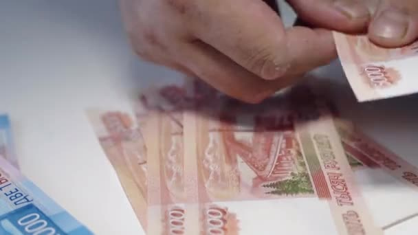 man giving money, Russian Ruble banknotes, over his desk i bribery and corruption concept.russian rubles banknotes. Financial theme. stack of banknotes in a mans hand.