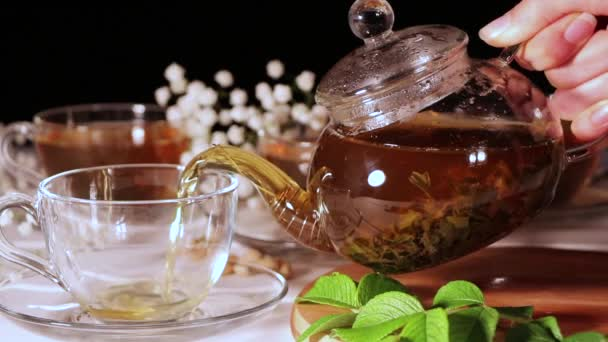 A Cup of green tea and a teapot. Flower tea with fruit slices. Tea ceremony, traditional drink. Afternoon tea, homelike. Flat lay. Oriental, cozy, preparation, heat, tradition, japanese, leafy, herbal