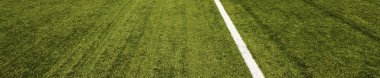 Modern football field with artificial lawn