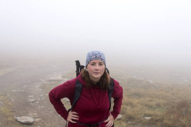 Woman in the mountains fog