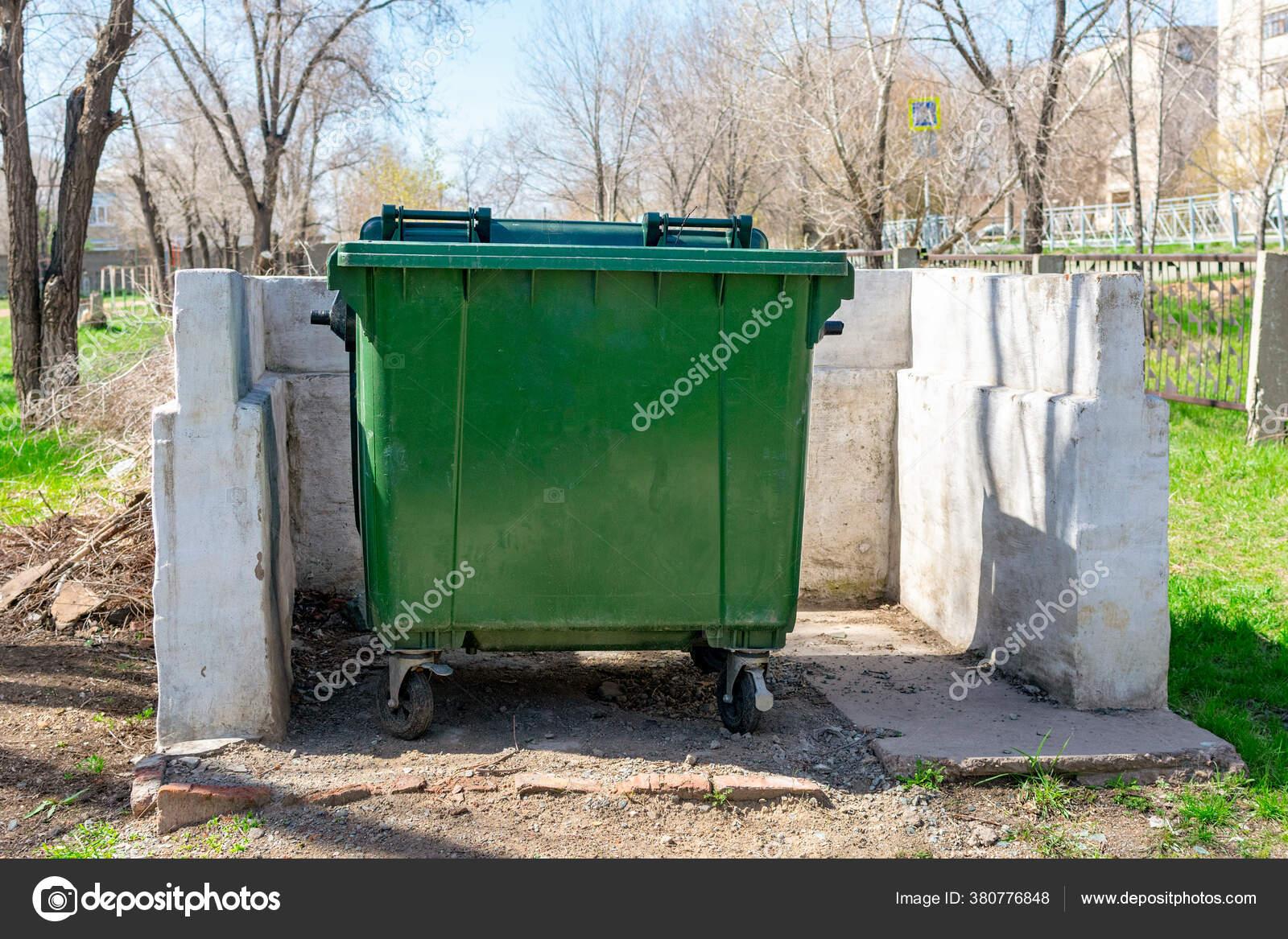 Green Trash Can Wheels Stands Site White Concrete Fence Public Stock Photo C Ksu Ksv 380776848