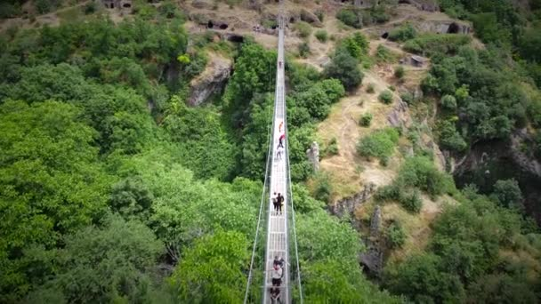 Aerial Drone View of Canyon rope suspension bridge full of tourists