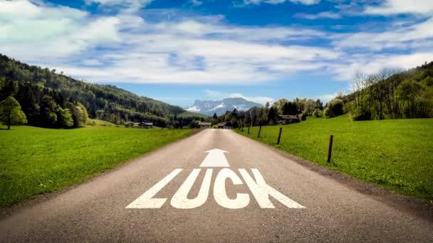 Straßenschild weist den Weg zum Glück