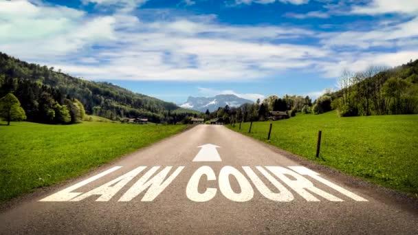 Straßenschild weist den Weg zum Gericht