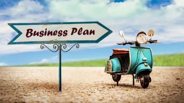 Straßenschild weist Weg zum Businessplan