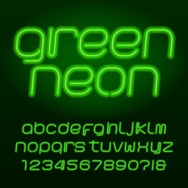 Green neon tube alphabet font. Neon color lowercase letters, numbers and symbols. Stock vector typeset for any typography design.