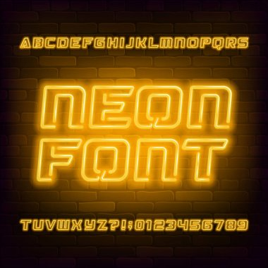 Yellow neon alphabet font. Futuristic light bulb capital letters and numbers. Brick wall background. Stock vector typescript for your typography design.