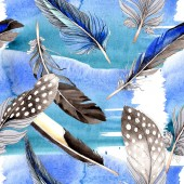 Bird feathers from wing. Watercolor background illustration set. Seamless background pattern. Fabric wallpaper print texture.