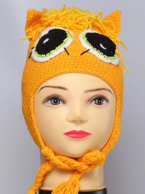 colored knitted children's winter hat made of wool